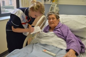 Irene Archer is surveyed by Staff Nurse Amy Barton
