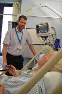 Dr Kneale Metcalf and a patient on the new monitor